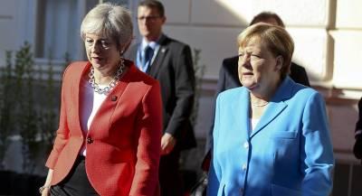 Меркель отказалась жать руку Мэй