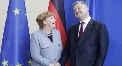Меркель едет к Порошенко из-за Донбасса