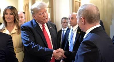 Путин и Трамп обменялись рукопожатиями в Париже